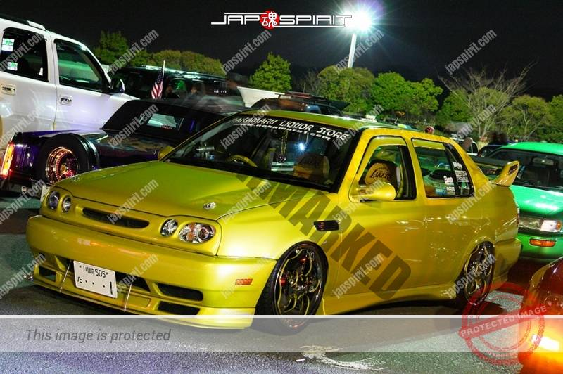 Photo of Volkswagen Jetta (Vento) lowrider style yellow color team Nakamura liquor store