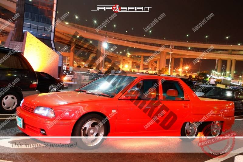 Nissan Avenir 6 wheel orange color custom with orange under lighting 1