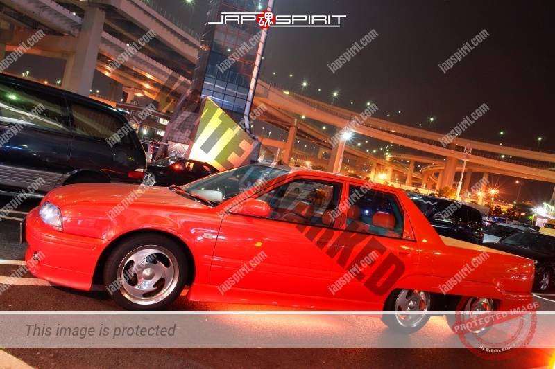 Photo of Nissan Avenir 6 wheel orange color custom with orange under lighting
