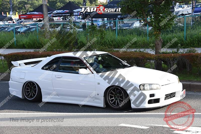 Photo of Stancenation 2016 Nissan Skyline R34 GTR hellaflush tsuraichi white body at odaiba