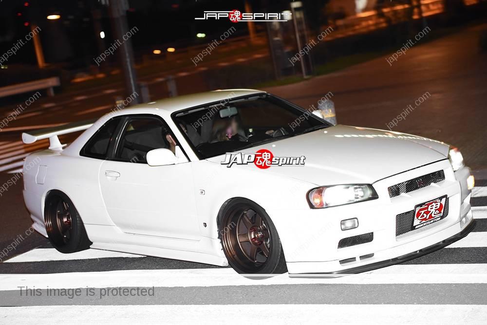 Photo of Stancenation 2016 Nissan skyline R34 GTR Hellaflush white boddy at odaiba