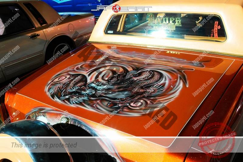 Lincoln continental lowrider style orange color with dragon air brush paint on the trunk (2)